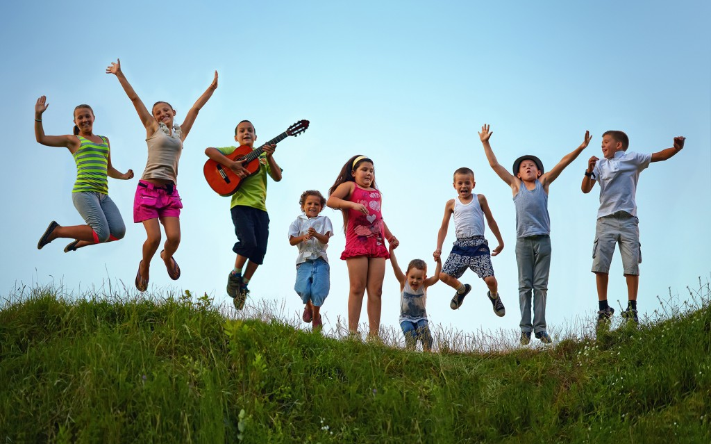 Happy-Kids-Jumping-On-Summer